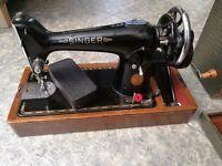 Singer vintage manual sewing machine with original case
