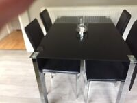 Glass black dining table.
