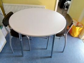 White round table and 2 chairs