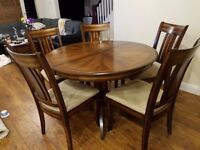 Pristine hardwood table and 6 chairs