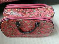 Pink oilcloth owl suitcase