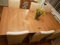 Solid dining table & 6 cream leather chairs
