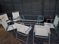 Glass top garden table & 6 chairs