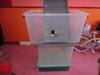Set of three plastic storage boxes