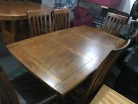 As new solid wood Table and 6 chairs