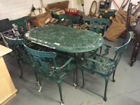 METAL GARDEN TABLE WITH SIX CHAIRS IN NEED OF RE-PAINT