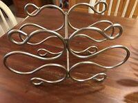 Silver coloured metal wine rack