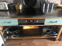 Electric hob, oven and kitchen bench