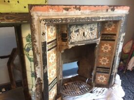 2 Vintage cast iron fireplaces with original tiles perfect for someone to restore