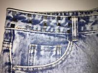Distressed denim shorts with studs