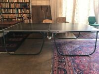 Foldable Jaques Tennis Table with net and tennis bats. Good condition.
