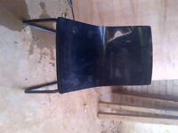 4 Black chairs on metal frame