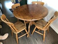 Solid pine dining table and 4 chairs. Can deliver.