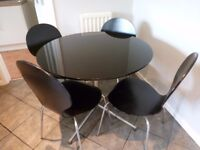 High gloss black table and 4 chairs