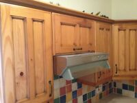 Kitchen , solid pine doors with matching brown cabinets, no appliances or sink.
