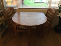 Dining table and chairs, fold down, increase the size to seat more.