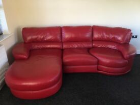 Stylish Leather sofa with foot rest and swivel chair. Excellent condition