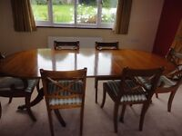 YEW DINING TABLE AND SIX CHAIRS (TWO CARVERS)
