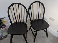 Two gold and black hand painted dining chairs