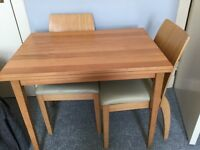 Beech table and 4 chairs .