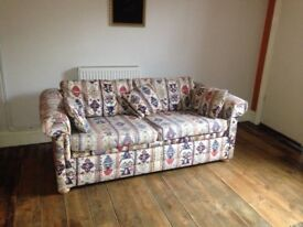 Good condition sofa bed in beautiful retro Aztec style pattern - incredibly comfy!