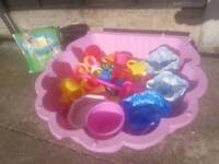 Girls pink Half Shell sandpit with extras and a little bit of sand