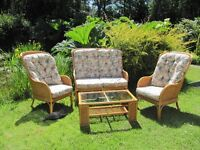 Conservatory furnitue. Sofa matchaing arm chairs coffee table wicker cane good condition