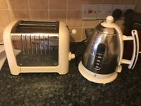 White and silver toaster and kettle set