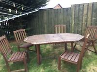 Wooden garden table and 5 chairs