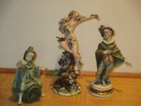 Two Italian porcelain figurines and one German figurine