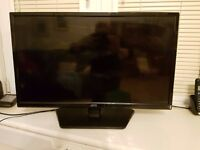 "Television with built-in DVD player (Logik L29HED13 28.5"" LED)"