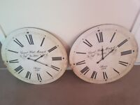 Two large wall clocks