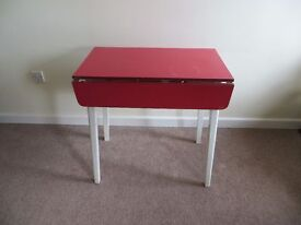 Red Formica drop leaf table