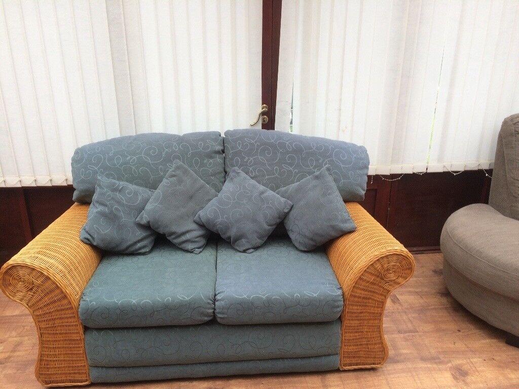 Two seater rattan sofas (x2)
