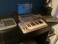Studio set up drum machine midi keyboard mixing channel contents microphone and interface