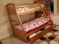 Wooden bunk bed with mattresses and box storage