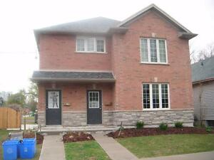 Upgraded 4 bdrm apartment with den near UWO . Available May 1st