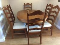 Large honeyed oak pedestal table and 6 chairs