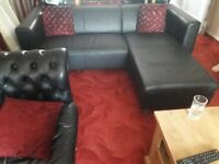 Black Italian leather corner sofa