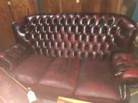 Three seater red leather chesterfield
