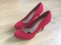 Women's red suede court shoes