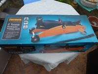 HALFORDS 2 tonne HYDRAULIC TROLLEY JACK. In original box. See photos for full details.