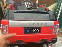 Brand new 2 seater Sit and ride red range rover 12v