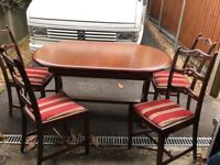 Lovely solid wood table with 4 matching chairs