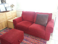 2 red Barker & Stonehouse two seater sofas (1 is sofa bed) + pouf