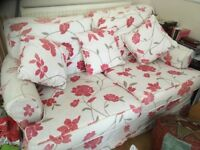 Pink and white flowery sofa