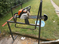 Chainsaw auto mount for cutting branches.