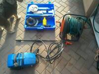 Power washer, plus hose reel and attachments.