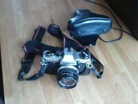 Olympus om-10 slr camera and 50mm lens/filter/case /strap as in pictures