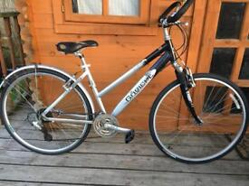 "Adults goricke Hybrid bike. 19"" frame. Back wheel buckle but still working"